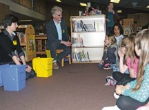 Ewa Kondek (left) and Frank Schork (right), from the garrison's Directorate of Public Works, speak with children from Sembach Elementary School during an Earth Day celebration April 22.