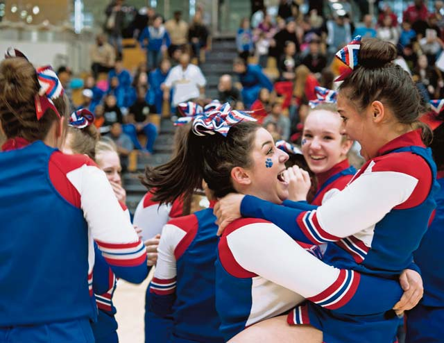Members of the Ramstein Royals cheer squad celebrate after winning first place in the Division I 2014 Cheer Competition. The Royals have earned first place two years in a row.