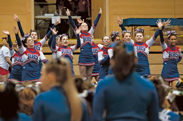 Members of the Ramstein Royals cheer squad finish their routine Feb. 22. The Royals won first place for Division I in the 2014 Cheer Competition.