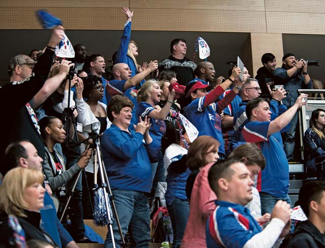 Fans root for the Ramstein Royals cheer squad during the cheerleading championship. Teams were graded on everything from tumbling to building.