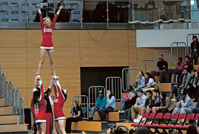 Members of the Kaiserslautern Raiders cheer squad perform their routine during the championship Feb. 22. The Raiders received the spirit award for Division I.