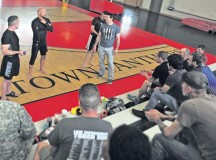 """From left, mixed martial arts fighters Marcus """"The Irish Hand Grenade"""" Davis, Frank Trigg, Cole """"The Apache Kid"""" Escovedo and Tim Kennedy talk to members of the KMC about their backgrounds during the Armed Forces Entertainment 2014 MMA All-Stars Summer Tour June 19 on Kleber Kaserne."""