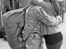 Courtesy photoSenior Airman Chris Willis is greeted by his wife, Rena, after returning home from a six-month deployment to Afghanistan May 15, 2013.