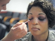 "Photo by Senior Airman Timothy MooreSenior Airman Liberty Provo, 86th Dental Squadron dental laboratory technician, applies makeup to Tech. Sgt. Erica Carr, 86th Communications Squadron KMC frequency manager, to simulate domestic violence injuries Oct. 2 on Ramstein. October is Domestic Violence Awareness Month, and this year's theme is ""Thanks for Asking."" Participants volunteered to don the fake injuries to raise awareness for domestic violence victims who sometimes remain silent."