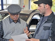 Photo by Elizabeth BehringDanny Sneed (right), a wreck assistant at Pulaski Auto Skills, goes over Andres J. Martinez Javier's worksheet after performing a free check on Javier's car Oct. 25 during U.S. Army Garrison Rheinland-Pfalz's biannual Vehicle Inspection Day. Javier works at the U.S. Army Medical Materiel Center, Europe, in Pirmasens. Sneed said the two most common errors he sees during auto checks are over-inflated tires, which can wear out quickly and be dangerous, and customers who don't get their oil routinely changed.