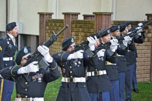 Soldiers from the Sembach-based 18th Military Police Brigade render a rifle salute in honor of Sgt. Joseph Peters during a service at Vogelweh chapel.