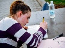 Ramstein High School senior Kayla Kessel writes a letter of encouragement to members of a Covenant House in the U.S. during the Solidarity Sleep Out event April 19 on Ramstein. The sleep out was organized by the Ramstein Keystone Club and was aimed at raising awareness for the homeless.