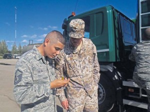 Master Sgt. Albert Black, 435th Contingency Response Group air adviser, discusses water detection in fuels with a Latvian navy  lieutenant commander at Lielvarde Air Base, Latvia.