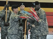 Photo courtesy of the U.S. ArmyCol. Koji D. Nishimura (left) and Command Sgt. Maj. George W. Grace Jr. (right), the commander and command sergeant major of the 30th Medical Brigade, uncase the 30th Med. Bde. colors during a ceremony Oct. 18 on Sembach Kaserne.  The unit re-designated from a command to a brigade as part of ongoing changes to the Army's organizational structure and is now a subordinate unit of the 21st Theater Sustainment Command.