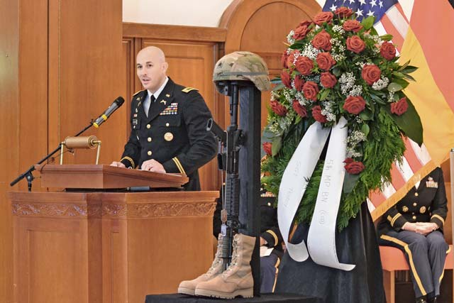 Chief Warrant Officer 2 Chris Kellenberger, Sgt. Joseph Peters' supervisor, gives the eulogy during a memorial for Peters, the first special agent from the U.S. Army Criminal Investigation Command to die in combat since the command formed in 1971.