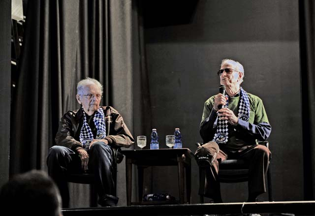 """William """"Bill"""" Prindible (left) and Julian """"Bud"""" Rice, World War II veterans and former 37th Troop Carrier Squadron C-47 Skytrain pilots, answer questions from members of Team Ramstein. Rice and Prindible were invited by the 37th Airlift Squadron to participate in events commemorating the 70th anniversary of D-Day."""