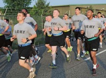 Photo by Brandon BeachSoldiers from the 21st Theater Sustainment Command participate in an early morning run June 12 on Rhine Ordnance Barracks in celebration of the 239th Army birthday. An official cake-cutting ceremony followed the run, which covered five kilometers.