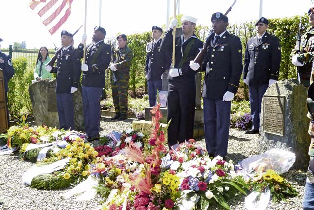 Color guard members from Landstuhl Regional Medical Center participate in a May 17 ceremony in Wereth, Belgium, honoring 11 African-American Soldiers murdered during World War II.