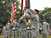 Lt. Col. James H. Walker (left), 95th Military Police Battalion commander, and Command Sgt. Maj. James W. Breckinridge, 95th MP Bn. senior enlisted adviser, case the colors of the 95th MP Bn. during an inactivation ceremony June 10.