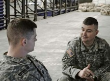 Maj. John Roache, operations officer with Headquarters and Headquarters Battery, 263rd Army Air and Missile Defense Command, discusses ballistic missile defense operations with Capt. William Westmoreland, operations officer with the 263rd, during a training exercise March 6.
