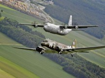 A Douglas C-47 Skytrain, known as Whiskey 7, flies alongside a C-130J Super Hercules from the 37th Airlift Squadron May 30 over Germany. The C-47 came to Ramstein for a week to participate in base activities with its legacy unit, the 37th Airlift Squadron, before returning to Normandy to recreate its role and drop paratroopers over the original drop zone in Sainte-Mere-Eglise, France.