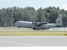 A C-130J assigned to the 37th Airlift Squadron lands on Lielvarde Air Base, Latvia, June 17 as part of the exercise Saber Strike 2014.