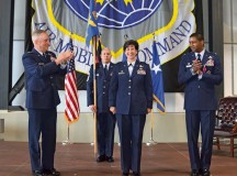"""Photo by 2nd Lt. Henry LancasterCol. Nancy Bozzer, 521st Air Mobility Operations Wing commander, is recognized by  Maj. Gen. Frederick """"Rick"""" Martin (left), U.S. Air Force Expeditionary Center commander,  Col. Randall Reed (right) and members of the wing during the 521st AMOW change of command June 18 on Ramstein."""