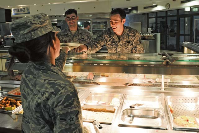 Airman Tiffani Ortiz, 786th Force Support Squadron food server apprentice, serves customers Oct. 8 in the Rhineland Inn Dining Facility on Ramstein. The Rhineland Inn Dining Facility provides Airmen with food to-go.
