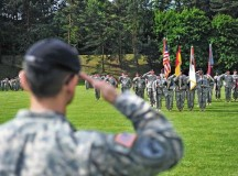 Col. Koji D. Nishimura, outgoing commander of the 21st Theater Sustainment Command's 30th Medical Brigade, salutes his Soldiers one last time during a change of command ceremony May 21 on Sembach Kaserne.