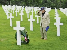 World War II veteran Pfc. Leslie Cruise salutes the gravesite of Pfc. Richard Vargas during a wreath laying ceremony June 2 at the Lorraine American Cemetery and Memorial.