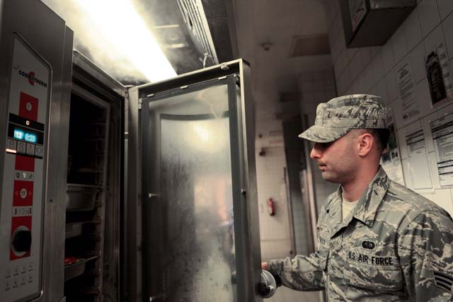 Senior Airman Jonathan DaSilva, 786th Force Support Squadron food service journeyman, opens a steamer Oct. 8 in Ramstein's Rhineland Inn Dining Facility to check the status of the food. The Rhineland Inn Dining Facility is open seven days a week, year-round to serve the needs of Ramstein's Airmen.