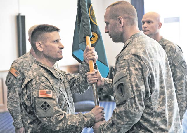 Photo by Staff Sgt. Alexander A. BurnettCol. Steven L. Hite (left), outgoing 19th Battlefield Coordination Detachment commander, accepts the organization's colors from Sgt. Maj. Richard E. Larson, 19th BCD sergeant major, during a change of command ceremony June 18 at the Ramstein Officers' Club.