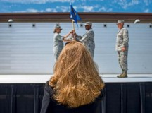 Teresa Bracher, 86th Airlift Wing chief of protocol, watches a change of  command dry-run July 17 on Ramstein. The wing protocol office is made up of a four-man team that provides support to approximately 22,000 military members and Department of Defense civilians.