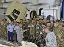Master Sgt. Wilfredo Rivera, 317th Maintenance Support Company, explains to 33 delegates from Conventional Forces Europe Treaty Compliance countries, who visited Baumholder June 26, what Soldiers do on a day-to-day basis in a motor pool. The delegates also received information  from U.S. Army Garrison Baumholder personnel about how Soldiers, family members and civilians live, work and play on a U.S. military installation.