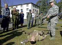 Tech. Sgt. Mariah Pike, 86th Airlift Wing self aid and buddy care adviser, explains to attendees of the 29th annual Aerospace Medicine Summit and NATO Science and Technology Organization Technical Course some of the capabilities of human simulators March 10 outside the Hercules Theater. Pike also demonstrated how the simulators are used to train Airmen.