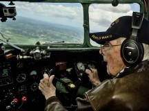 Bill Prindible, a veteran U.S. Army pilot who flew on D-Day, takes the controls of a C-47 Skytrain during a flight over Normandy June 5. Prindible was visiting Normandy as part of the 70th anniversary of the invasion of Normandy. More than 60 Ramstein Airmen traveled to Normandy to honor the sacrifices made by veterans of World War II.