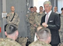 Secretary of the Army John McHugh speaks with transiting service members returning from Afghanistan during a visit to Mihail Kogalniceanu Air Base Sept. 20 in Romania.