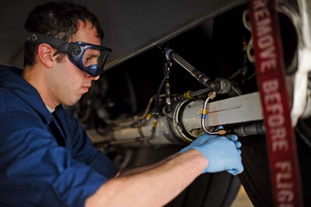Senior Airman Vasilis Vasilakis, 86th Maintenance Squadron hydraulics systems journeyman, changes a C-130J Super Hercules emergency brake line. The hydraulics team changes around 70 to 80 brakes a year.