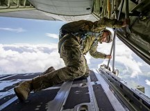 U.S. Army 1st Sgt. Leldon Lee Want, Special Operations Command Europe Joint Special Operations Air Component senior enlisted leader, looks out the back ramp of a U.S. Air Force C-130J Super Hercules to ensure Romanian paratroopers can safely exit the aircraft during Carpathian Spring 2014 May 18 above Campia Turzii, Romania. Jumpmasters from Ramstein and Royal Air Force Mildenhall, England, took part in the training to help guarantee jumps went smoothly.