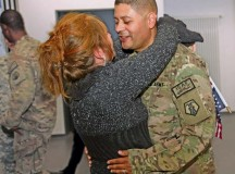 Army Reserve Staff Sgt. Johnny Sarabia, a member of the 209th Digital Liaison Detachment (Forward), hugs his wife, Claudia, for the first time in over four months Oct. 7 during a redeployment ceremony for 28 Army Reserve Soldiers from the 7th Civil Support Command's 209th DLD (FWD) and the 406th Human Resources Company, as they arrived from missions supporting Operation Enduring Freedom in Afghanistan, Kuwait and other Middle Eastern countries.