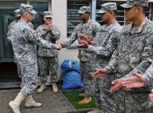 Photo by Pfc. Kelsey M. LittleLt. Gen. Donald M. Campbell Jr. (left), commanding general of U.S. Army Europe, presents a USAREUR challenge coin to Spc. Joshua Middleton, corrections specialist with the 18th Military Police Brigade, 21st Theater Sustainment Command, during his visit to Sembach Kaserne Oct. 9. Middleton was recognized for serving over 200 community service hours.