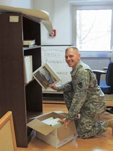 Sgt. 1st Class John Hickman, 409th Contracting Support Brigade, unpacks files in the new 409th CSB headquarters location in Sembach.