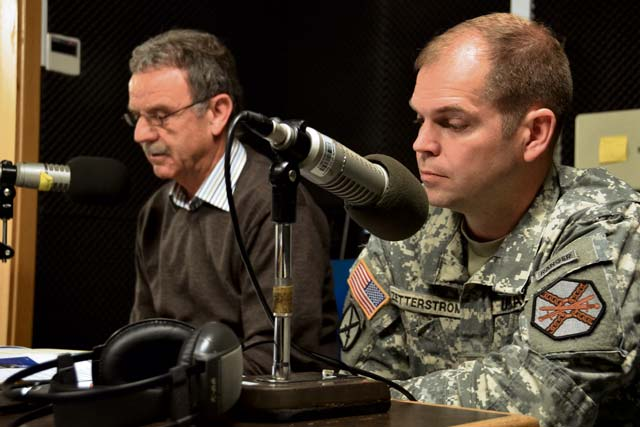 "Lt. Col. Lars Zetterstrom (right), U.S. Army Garrison Kaiserslautern commander, and Paul Lindemer, a public works employee, talk on American Forces Network radio. On Wednesday, Zetterstrom will hold a ""Commander's Corner"" — a hybrid radio and Internet-based event."