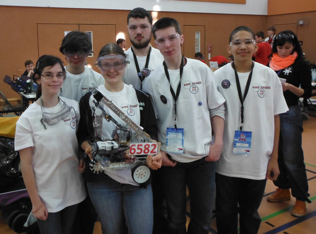From left, Ellie Burnett, Thomas Dore, Katie Merchat, Josh Merchat, Kaleb Steed and Matthew Jackson, members of the Kaiserslautern High School Robotics Club, pose for a photo during the first Technology Challenge, a competition held recently in Vilsek, Germany.