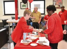 Mary Jane Spreier (left) and Emma Robinson serve cake during the grand opening of the Baumholder Warrior Zone on Smith Barracks in Baumholder. The new Warrior Zone is located in Bldg. 8106 next to the Hall of Champions.