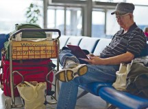 Photo by Tech. Sgt. Chad Thompson A retiree sits and waits for a Space-A flight May 10 in the Ramstein Passenger Terminal.