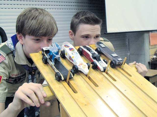 Boy Scouts Braeden Jepsen and Ty Ducheny prepare to launch four pinewood derby cars along the wooden racing course during the Pack 69 Pinewood Derby Jan. 24 at Vogelweh Elementary School.