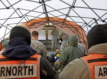 Capt. Jon Underberg, survey team leader, 773rd Civil Support Team, 7th Civil Support Command, gives an initial mission brief Feb. 6 during an Army North Training Proficiency External Evaluation of the 7th CSC's 773rd CST's unit readiness to respond to a real-world Chemical, Biological, Radiological or Nuclear event, Feb. 2 to 12.