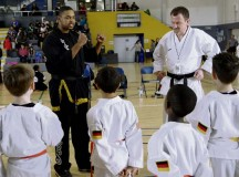 Travis Gentry (left), Kuk Sool Won instructor, and Manfred Bemme, Loveless Okinawan Karate Academy, explain the rules of the sparring division to participants during the 15th annual U.S. Air Forces in Europe martial arts tournament Feb. 28 at Ramstein.