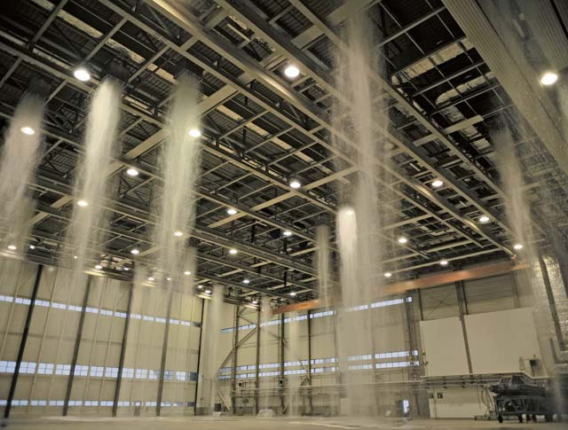 Water is emitted through foam generators during a biennial fire suppression system test Feb. 19 on Ramstein. There are two water storage tanks, each of which takes approximately 26 minutes to empty and run through the drainage system.