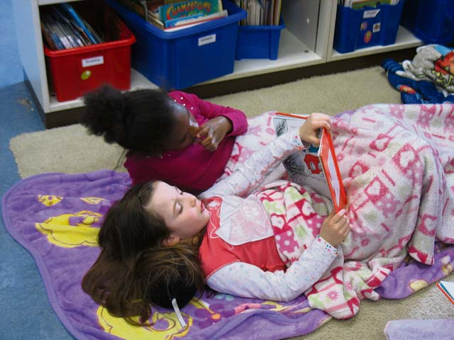 "Courtesy photoLandstuhl Elementary/Middle School students Ashlee Comfort and Trinity Shimmer read the book ""Green Eggs and Ham,"" by Dr. Seuss, in Julie Wittenberg's first grade classroom during National Read Across America Day."