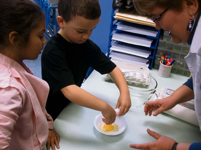 Courtesy photoLandstuhl Elementary/Middle School students Kyra Querido and William Moreau make green eggs and ham in Julie Wittenberg's first grade classroom during National Read Across America Day.