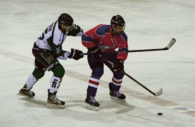 A player from the KMC Eagles 1 hockey team faces off against an opposing player during a game Feb. 25 in Viernheim, Germany. The Eagles 1 were named the 23rd annual Armed Forces Alpine Classic Division I Champions during a tournament in Garmisch-Partenkirchen, Germany.