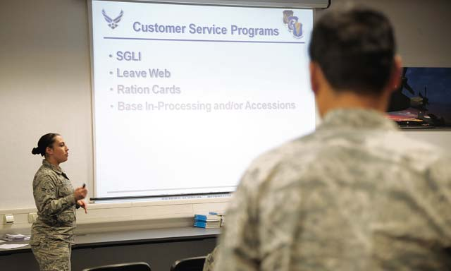 Airman 1st Class Danelle Oliver, 786th Force Support Squadron customer service technician, briefs newcomers about the customer service programs available through the 786th FSS Customer Support office March 12 on Ramstein. Airmen from the 786th FSS brief approximately 60 Airmen a week at the Ramstein in-processing line.