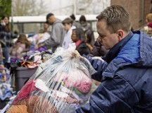 Maj. Matthew Boyd, 86th Airlift Wing chaplain, sorts clothing for the less fortunate during a donation event Feb. 21 in Kaiserslautern. Airmen from Ramstein Air Base worked alongside volunteers in the KMC to distribute clothing and food for the less fortunate.